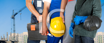 Royalty Free Photo of Workers Standing In Front of a Building