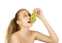 Royalty Free Photo of a Woman Eating Grapes