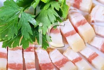 Royalty Free Photo of Sliced Pig Lard With Greens