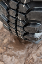 Close up of a car tire on a dirty road.