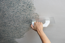 Pasting liquid wallpaper in the apartment
