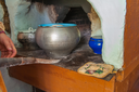 Cooking meals in a Russian stove, soup with meat and groats