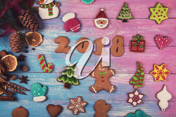 Gingerbreads for new 2018 year on wooden background, xmas theme