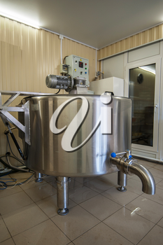 Cheese production at dairy farm, first stage - milk processing