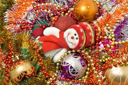 Christmas greetings - Funny white snowman and decoration balls over white