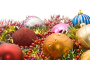 Group of Beautiful Christmas decoration balls and tinsel over white. Focused on one ball
