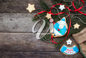 Xmas and New Year 2015 sheep cookie and pastry on wood in rustic style. Free space for text