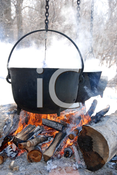 Royalty Free Photo of Kettles Over Open Fires