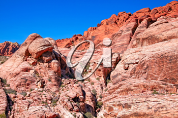 View of dry landscape and red rock formations of the Red Rock Canyon in the Mojave Desert.