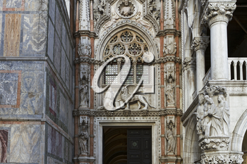 Venice, Italy - April 1, 2013: Street views of ancient architecture in Venice, Italy. Venice is a city in northeastern Italy sited on a group of 118 small islands separated by canals and linked by bri