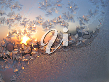 frost and sun on winter glass background