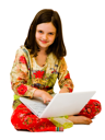 Caucasian girl using a laptop and smiling isolated over white