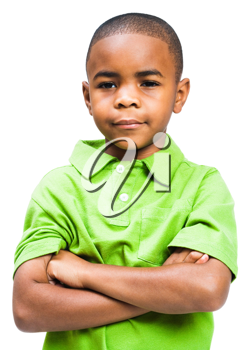 Close-up of a boy thinking with his arms crossed isolated over white