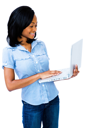 Latin American woman using a laptop and smiling isolated over white