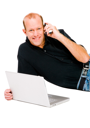 Caucasian man using a laptop and a mobile isolated over white