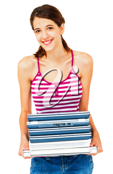 Smiling woman holding a stack of laptops isolated over white