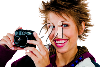 Beautiful woman photographing with a camera and smiling isolated over white