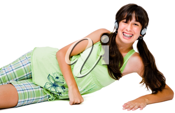 Portrait of a teenage girl wearing headphones and listening to music isolated over white