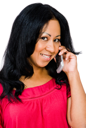 Happy woman talking on a mobile phone isolated over white