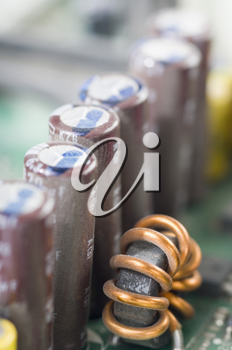 Close-up of capacitors in a circuit board
