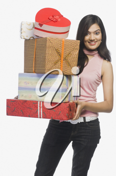 Woman holding gift boxes and smiling