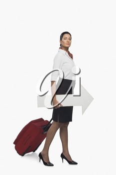 Air hostess carrying luggage with an arrow sign