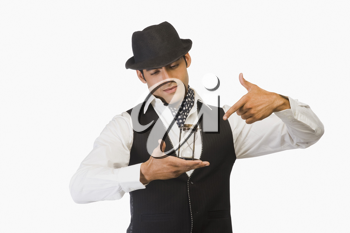 Businessman holding an hourglass and pointing at it