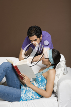 Couple reading a book together