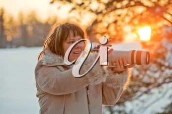 Royalty Free Photo of a Woman Taking Pictures at Sunset