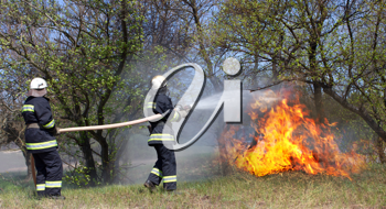 Royalty Free Photo of Firefighters Fighting a Blaze