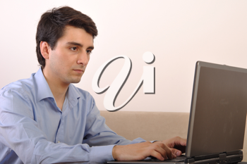 Royalty Free Photo of a Man on a Laptop