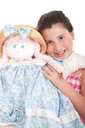 Royalty Free Photo of a Little Girl Holding a Doll