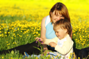 Royalty Free Photo of a Woman and Child in a Meadow