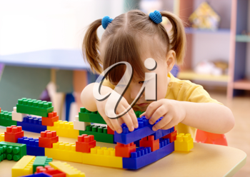 Royalty Free Photo of a Little Girl With Building Bricks