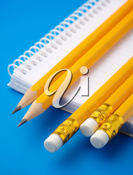 Royalty Free Photo of Pencils and a Notepad