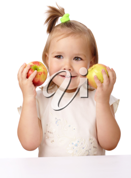 Royalty Free Photo of a Little Girl With Apples