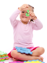 Royalty Free Photo of a Little Girl Holding a Piece of an Alphabet Puzzle