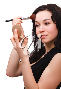 Royalty Free Photo of a Young Woman Applying Powder