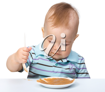 Royalty Free Photo of a Baby Boy Eating Pur�e