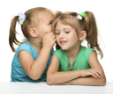 Royalty Free Photo of Two Girls Whispering