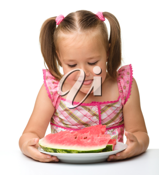Royalty Free Photo of a Little Girl Eating Watermelon