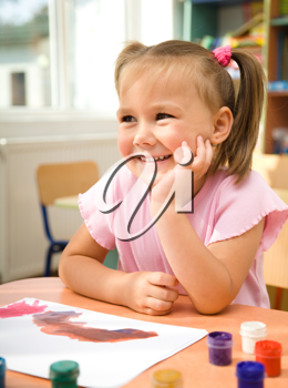 Royalty Free Photo of a Little Girl Painting