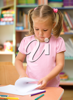Royalty Free Photo of a Little Girl Drawing With a Marker