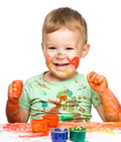Child is grabbing some paint using fingers, isolated over white
