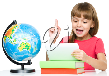 Young girl is using tablet and pointing up while studying geography, isolated over white
