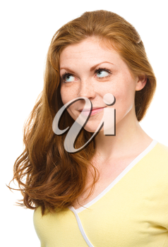 Young woman is looking up and smile, isolated over white