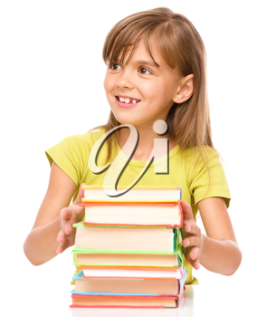 Portrait of a little girl embracing her books, isolated over white