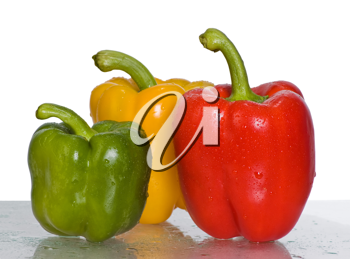 Three peppers isolated on white background.Focus on the red and green