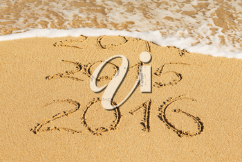 digits  2014,2015 and 2016 on the sand seashore - concept of new year and passing time