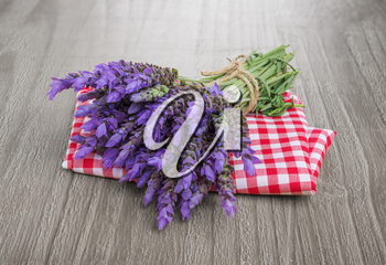 bundle of lavender flowers  on checkered tablecloth and vintage wooden table